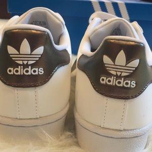 adidas Shoes - Adidas Superstar white w/bronze stripes